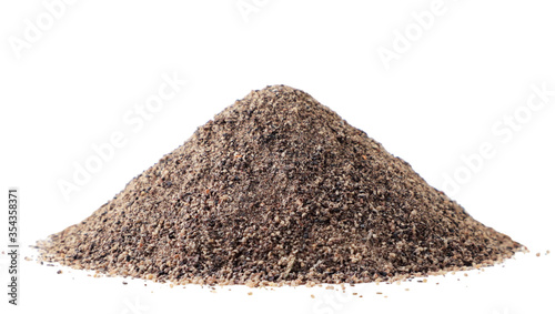 Pile of black ground pepper close-up on a white background Canvas-taulu