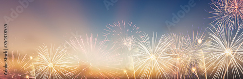 Obraz Celebration colorful firework on pattern on sky background concept for USA 4th july independence day, symbol of patriot freedom festive,Abstract happy new year 2021 with copy space for display - fototapety do salonu