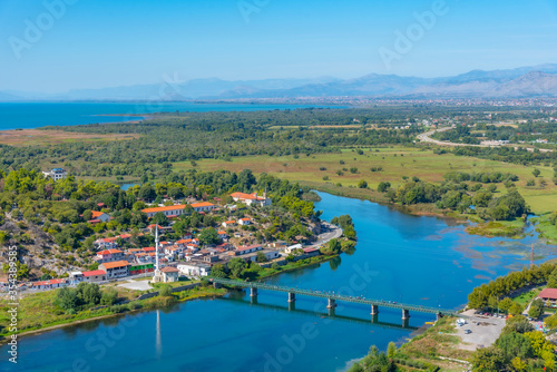 Aerial view of Buna river and adjacent village near entrance to Skadar lake in A Canvas Print