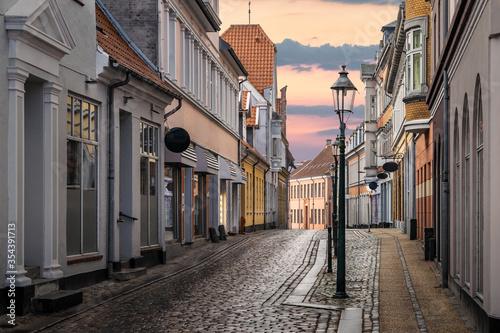 Fotografie, Obraz A beautiful colorful street at sunset in Viborg, Denmark