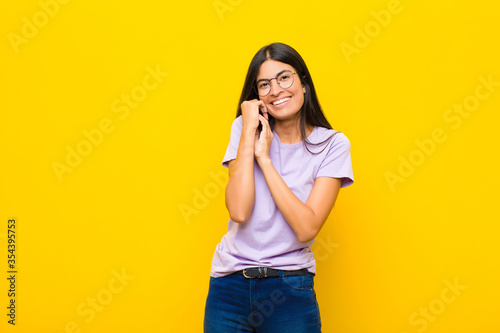 young pretty latin woman feeling in love and looking cute, adorable and happy, s Wallpaper Mural