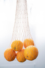 String Bag With Fresh Oranges ...