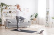canvas print picture - Sporty Senior Woman Practicing Yoga With Online Tutorials At Home