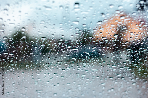 Photo Drops of rain are on frontal glass of car