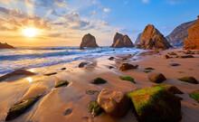 Ursa Beach In Portugal. Atlantic Coast Of Atlantic Ocean. Sunset And Rocks Sun Waves And Foam At Sand Of Coastline Picturesque Landscape Panorama.