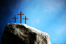 Three Crosses Against Blue Sky On Calvary Hill Background. Crucifixion, Resurrection Of Jesus Christ. Christian Easter Holiday, Golgotha. He Risen And Alive. Jesus Is The Reason. Gospel, Salvation