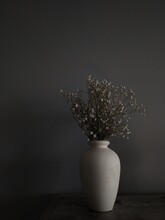 Dried Flower Vase.Ekibana Art.clay Vase With Dried Flowers On A Dark Background In The Interior.