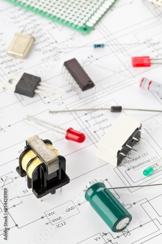 Obraz Different electronic parts or components on pcb wiring diagram with resistors, capacitors, diode and ic chips - fototapety do salonu