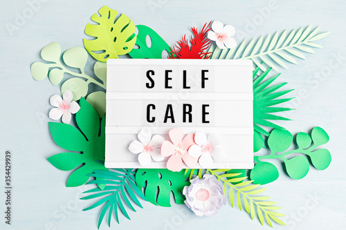 Slika na platnu Lightbox with motivation words for self care, positive thinking, mental health,