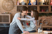 Father Daughter Connection. Cute Little Girl Bonding With Dad In Kitchen
