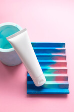 White Moisturizer Cream Tube On Abstract Concrete Decor On Cute Pink Background And Copy Space For Text. Mockup Hand Moisturizer, Shampoo Or Facial Cleanser Container