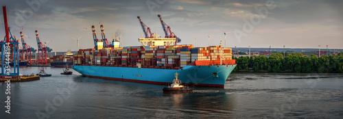 Fototapeta huge container ship at sunset in the port of Hamburg obraz