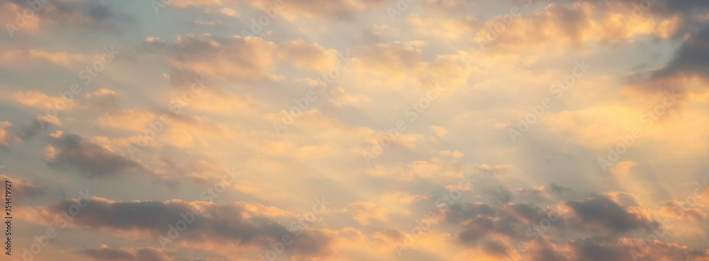 Fototapeta Beautiful sunset sky above clouds with dramatic light