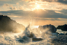 Big Waves Splash Up To The Sky With Sun. Sunset At Sea. Storm. Seascape.
