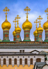 Golden Onion Domes And Crosses Atop The Kremlin's Church Of The Nativity, Constructed In 1393 In Moscow, Russia