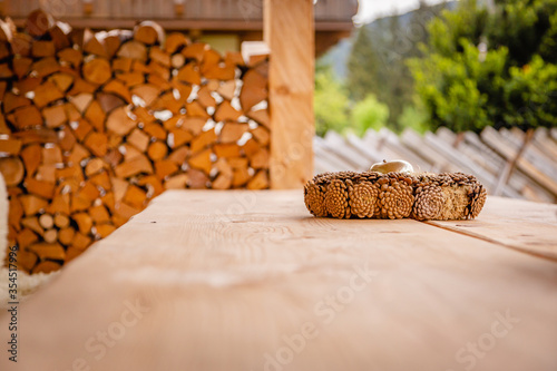 Fotografie, Obraz New stylish wooden table outside of a modern lodge inviting to relax and enjoy