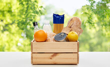 Eating, Grocery And Delivery Concept - Food In Wooden Box On Table Over Green Natural Background