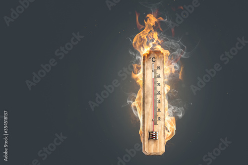 Foto Hot temperature - Thermometer on fire