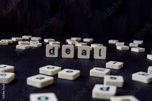 Word or phrase DEAL made with  letters on the wood, great image for your design Wallpaper Mural
