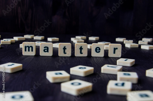Word or phrase MATTER made with  letters on the wood, great image for your design Canvas Print