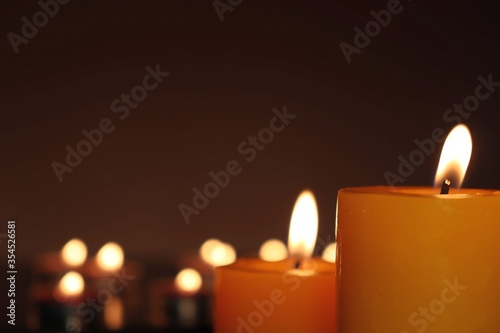 Candle black background of mourning funeral moment of silence Wallpaper Mural