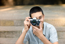 Young Teenage Boy Photographing The Viewer