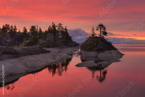 Fotografia, Obraz Small Islands on the lake in the pink dawn, lake Ladoga, Republic of Karelia, Ru