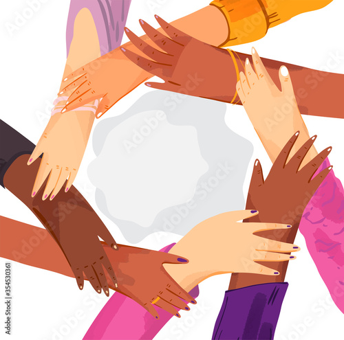 Hands of diverse group of women putting together in circle Fototapeta