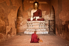 Buddhist Monk Sitting And Pray...