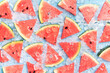 Leinwandbild Motiv Watermelon slice popsicles on a blue rustic wood background