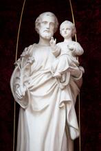 Saint Joseph With Jesus Savior Marble Sculpture. Saint Josef Statue In The Church.