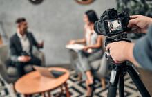 Female Journalist Interviewing Business Man