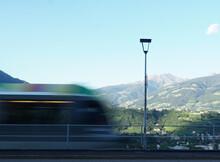 Colourful Regional Train Blurred Moving, Merano, Alto Adige, Italy.