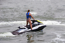 Young Tall And Slender Woman Jet Skier