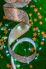 Christmas background with ribbon, golden stars and little lights