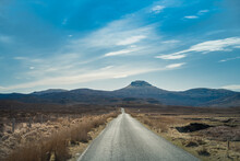 Country Road Surrounded With Beautiful Landscape Scenery On The Old Man Of Storr The Landmark In The Area Of Scottish Highlands