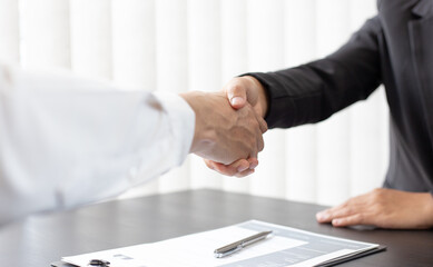 Close-up of Head of Human Resources and new employees Shake hands to congratulate them on their collaboration, Successful job interviews and the willingness to work together concept.
