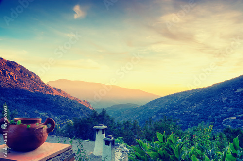 Fototapeta Sunset overlooking the rooftops of the traditional white walled village of Bubio
