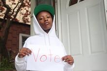 Black Kid Holding White Paper ...