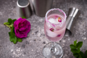 Pink cocktail with champagne and rose syrup