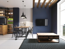Area With A TV In A Studio Apartment With A Loft Style Kitchen. Wooden Designer Dining Table And Modern Kitchen.