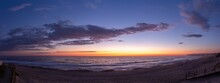 Panoramic Shot Of A Colorful Breathtaking Sunset Over The Ocean