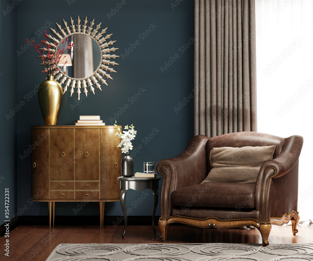 Fototapeta A classic leather armchair with a brown pillow, near the golden chest of drawers with decor, by the window.