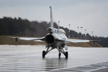 F16 Fighter Jet From Behind On The Wet Ground In Poland During Presentation
