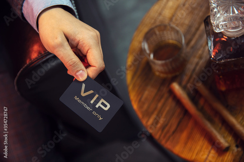 Photo Man holds VIP member card