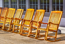 Rocking Chairs In A Row On An Outdoor Porch