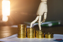 Wooden Hand Mannequin With Finger Walking Up Steps Of Golden Coins, Representing Free Of Loan Mortgage Or Debt Payment, Concept Of Saving Money For Future, Counting Money, Becoming Financial Freedom
