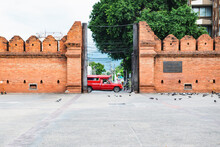 Thailand - June 19, 2019 : Tha Phae Gate And Old Wreckage Wall With Chiang Mai Local Red Cab Taxi Passing Background, Chiangmai