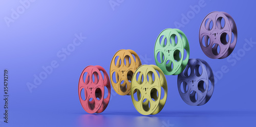 3D illustration of film reels arranged in a rainbow hue Fototapet