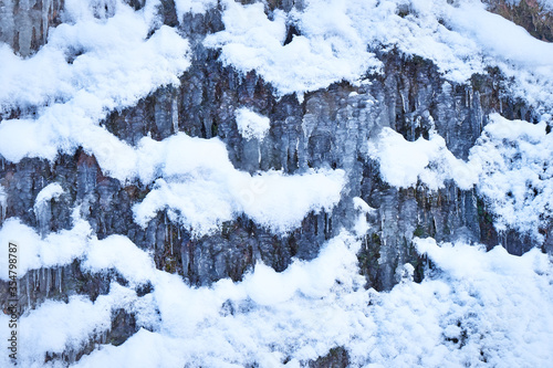 Icy waterfall on a mountain river. Wallpaper Mural